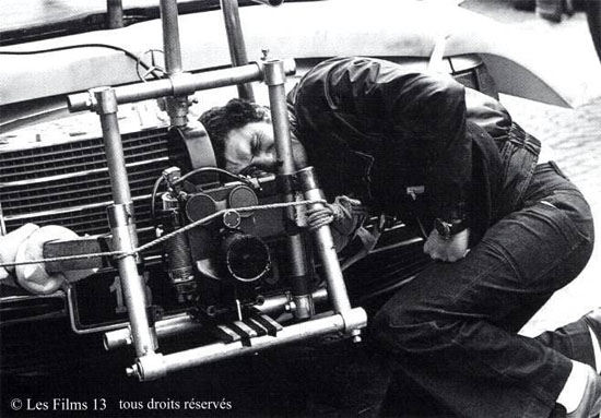 Claude Lelouch adjusts the camera mounted on the front of a Mercedes 6.9 before filming C'etait un Rendez-vous in just one take